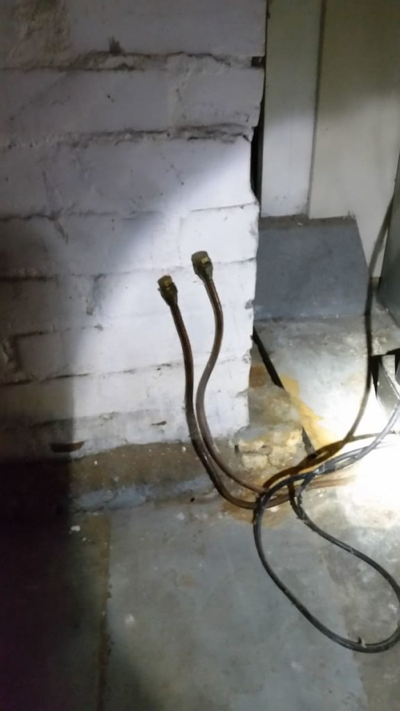Oil Tank Signs: oil supply lines in basement
