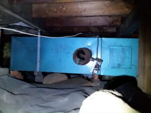 Photo of oil burning furnace in crawlspace