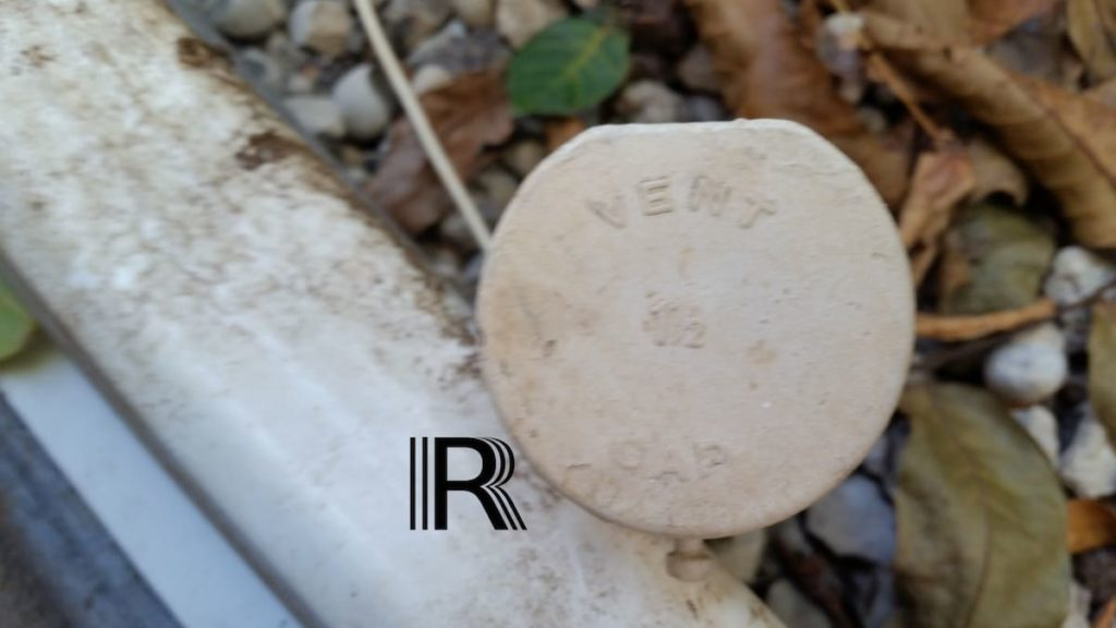 Rush Locates presents: Oil Tank Signs - a picture of a vent pipe cap