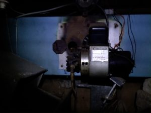 Photo of Oil pump section of oil burning furnace found in crawlspace